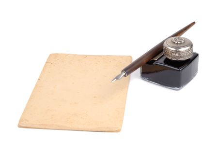 Old fashioned pen, ink-pot and piece of paper isolated over white background Stock Photo