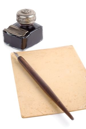 vintage parchement: Old fashioned pen, ink-pot and piece of paper isolated over white background Stock Photo