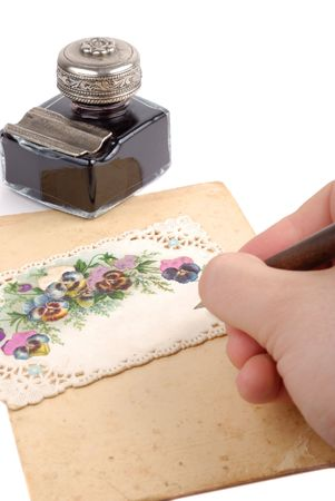 vintage parchement: Male hand writing on postcard isolated over white background