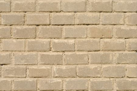 Fragment of new brick wall with stucco photo
