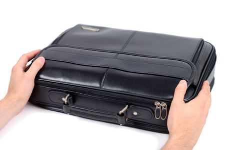 graft: Male hands holding black briefcase over white background Stock Photo