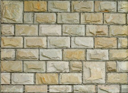 Fragment of new decorative brick wall with stucco photo