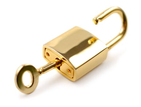 Golden padlock with key isolated over white background