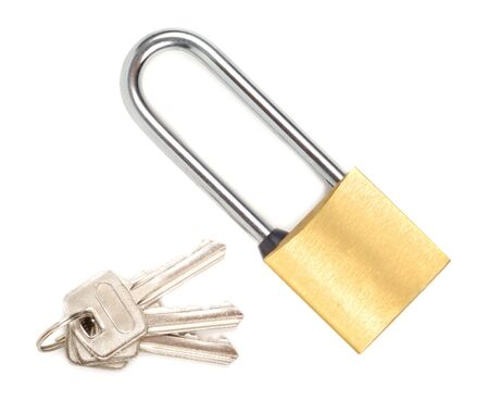 golden  gleam: Set of padlock and keys isolated over white background  Stock Photo