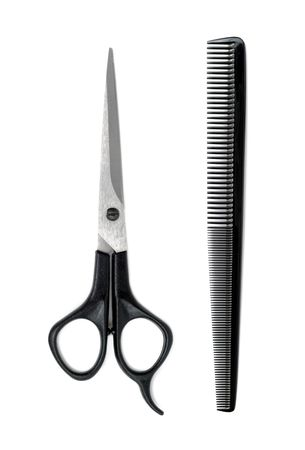 Black scissors and comb isolated over white background