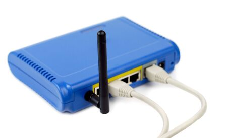 Modern blue wifi router with cables isolated over white photo