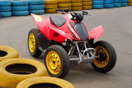 bounds: Single 4-wheeler near tyre bounds of race road. Urban scene.