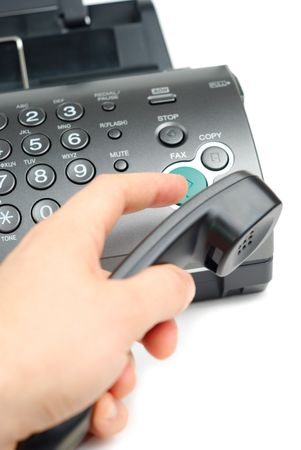 Male hand pushing send button on fax isolated over white Stock Photo