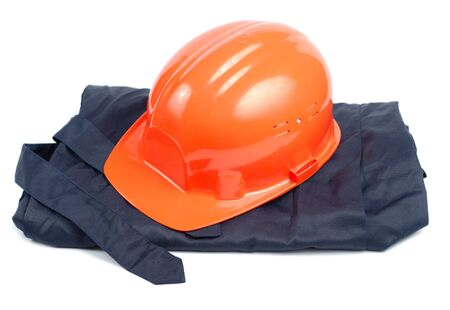 Orange helmet and blue uniform over white background Stock Photo - 3764078