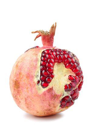 pommegranates: Red peeled pomegranate isolated over white background