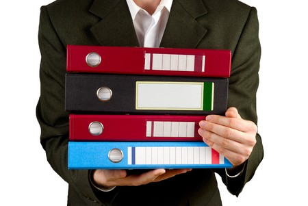 business metaphore: Male figure with stack of files isolated with path over white Stock Photo