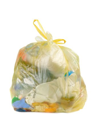 garbage bag: Yellow parcel with garbage isolated over white Stock Photo