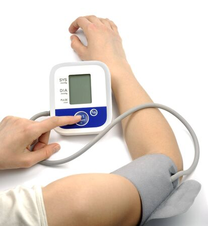 Female hands with blood-pressure meter isolated over white photo