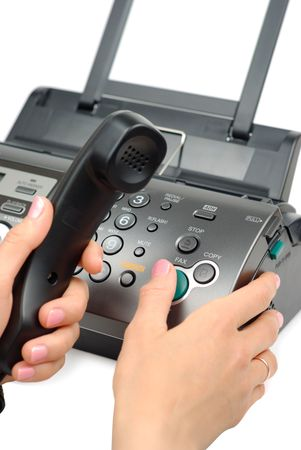 Female hand pressing start button on fax isolated over white photo