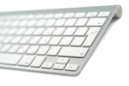 Wireless metallic keyboard isolated over white background Stock Photo