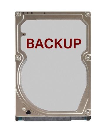 disco duro: Notebook con unidad de disco duro de copia de seguridad etiqueta de color rojo aisladas sobre fondo blanco Foto de archivo