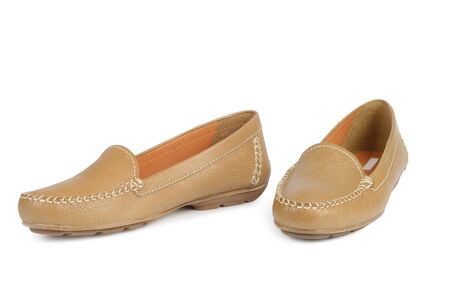 sewn up: New brown moccasins isolated with clipping path over white background