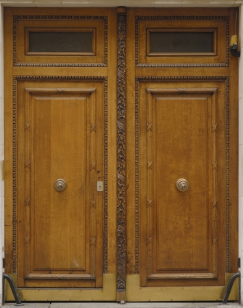 Massive old doors with nowadays addons photo