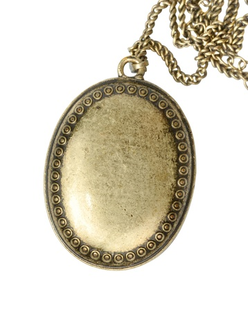 locket: Closed brass medallion isolated
