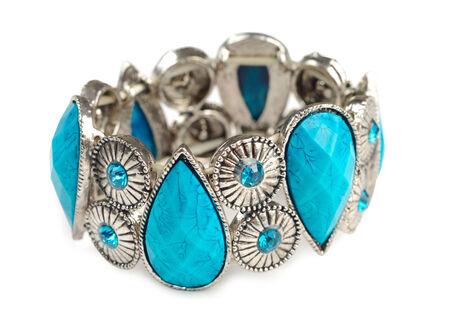 Bracelet with blue stones isolated over white background. photo