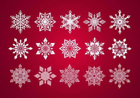深い赤の背景にクリスマスのための様々 な細かいレース雪片のセット