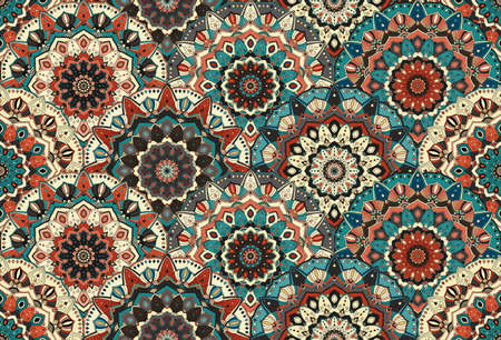 elaborate: Scales seamless pattern from flower mandalas. . Elaborate floral ornament for fabric print, furniture, wallpaper, greeting card. Unusual round design elements boho decoration.