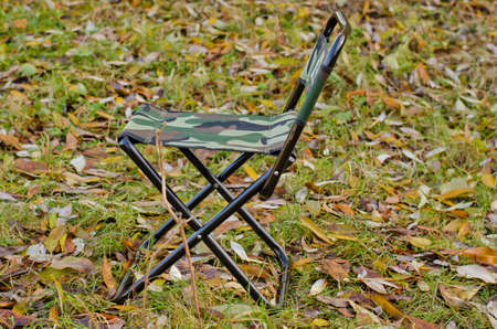 fishing rod and folding chair photo