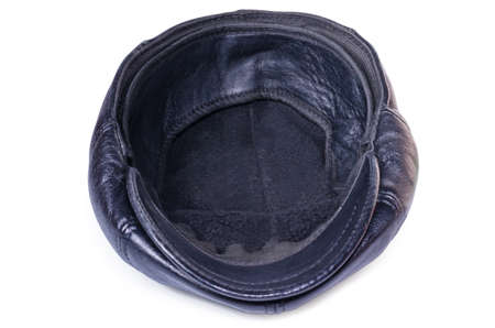 The turned leather cap close up on a white background asks money, alms photo