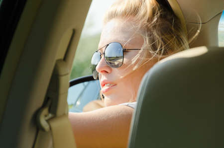 Close up portrait of blond female driver with sunglasses Stock Photo - 14826315