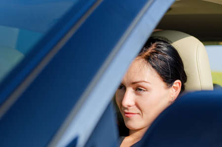 View through the window of a beautiful woman sitting in a car with her head resting on the headrest Stock Photo - 14826323