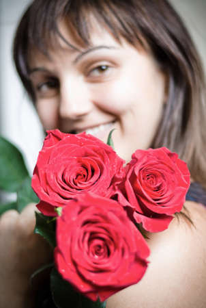 beautiful young woman with a bouquet of red roses Stock Photo - 14931097