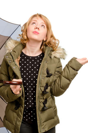 dubious: Dubious woman holding a large umbrella standing looking up watching the weather as she tries to decide whether it is going to rain or not isolated on white Stock Photo