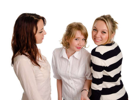 High angle view of three playful beautiful young woman in trendy modern outfits posing for the camera on a white studio background photo