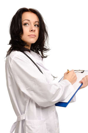 Hardworking female nurse or doctor busy writing notes looking up photo