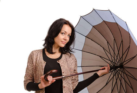 gusty: Beautiful Caucasian young brunette woman holding an umbrella Stock Photo