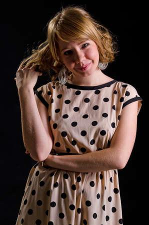 Studio portrait of smiling Caucasian girl in polka-dot dress Stock Photo - 17413024