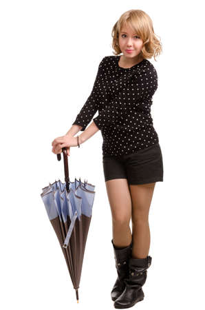 pert: Sexy young blonde woman posing with an umbrella in a stylish modern miniskirt and boots isolated on a white background Stock Photo