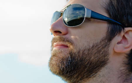 Handsome man's face with a beard and mustache photo