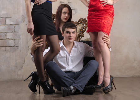 Portrait of three women and one guy posing in a close up shot photo