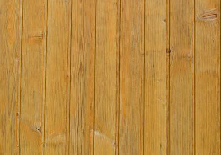 Wood cladding background texture in a light coloured wood with neat parallel planks photo