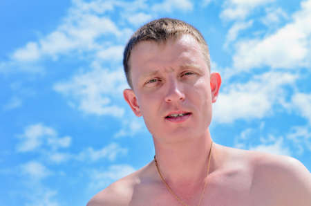 20 24 years old: Portrait of a young man against blue sky