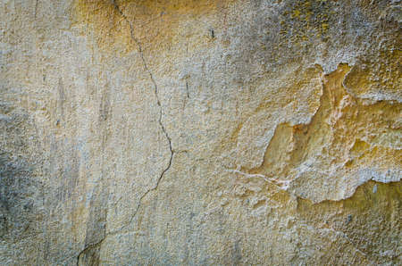 Background texture of and old cracking wall with falling concrete parts Stock Photo - 20200140