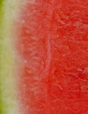pips: Sliced watermelon texture and background showing the juicy watery refreshing pink pulp and pips of this healthy fruit