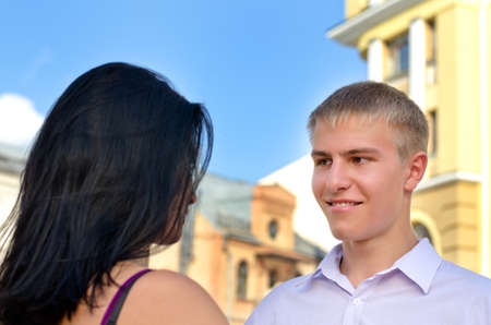courting: Portrait shot of an attractive blonde man smiling at his girlfriend  Stock Photo
