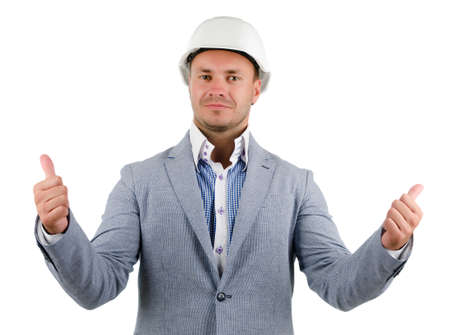 Man wearing a hardhat cheering in jubilation and punching the air with his fist as he celebrates a success, conceptual of a builder, architect or engineer photo