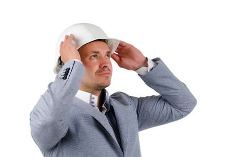 Close up Middle Age Engineer in Gray Coat and White Helmet Thinking New Ideas with Lifted Hands. photo