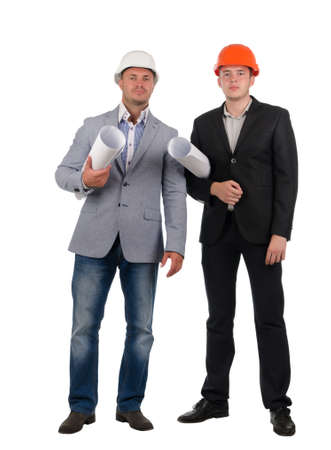 inscrutable: Confident young architectural team wearing hard hats and suits staning side by side looking at the camera with rolled blueprints under their arms, isolated on white Stock Photo