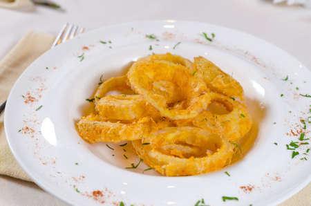 mouth watering: Looking Down at Bowl of Onion Rings at Fancy Table Setting Stock Photo