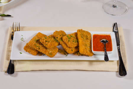 mouth watering: Gourmet Appetizing Recipe with Dip Sauce on Rectangular White Place Served on White Table.