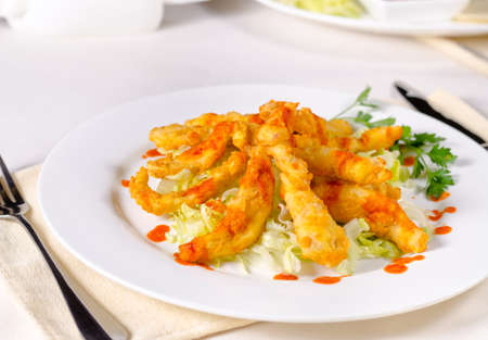 Appetizing Main Course on White Plate Served on Table with Utensils on Sides. Ready to Eat Food,